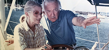 Judith Morgan and Walter Cronkite sail off the coast of Maine circa 1994.