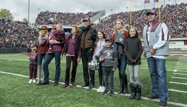 The Washington family during the homecoming football game